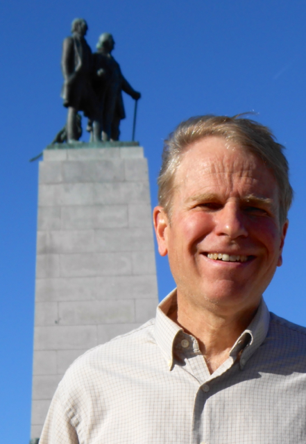 Claron Twitchell with Brigham Young statue in background at This Is The Place Park in Salt Lake City, Utah