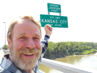 Claron Twitchell entering Jackson County, Missouri on Chouteau Trafficway bridge, Kansas City, Missouri